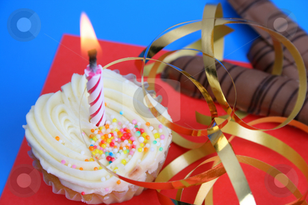 Birthday Cake stock photo, Birthday cake with golden ribbon and a candle by Vanessa Van Rensburg