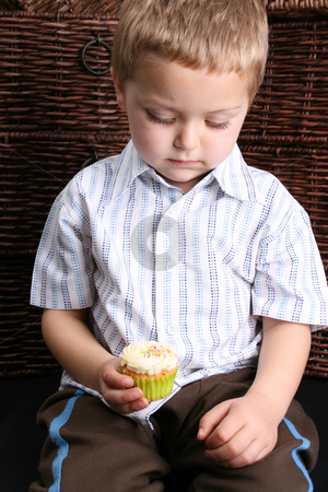 Beautiful Blond Boy stock photo, Beuatiful Blond toddler looking down at his cupcake by Vanessa Van Rensburg