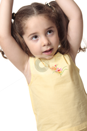 Toddler girl arms above head stock photo, Closeup of a little girl with hands stretched above her head. She is wearing a yellow top with embroidery and has hair in ponytails. by Leah-Anne Thompson