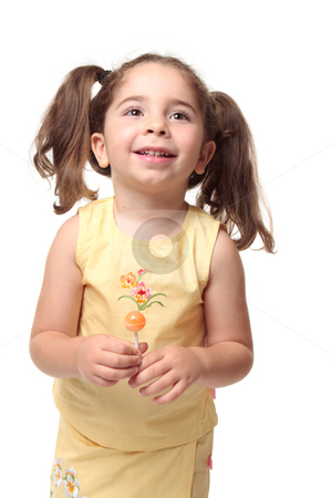 Happy smiling preschool girl in pigtails stock photo, Happy laughing child in yellow outfit and hair in pigtails by Leah-Anne Thompson