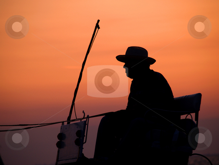 Cowboy stock photo, Cowboy in coachman by Portokalis