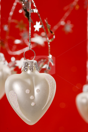 Christmas decoration stock photo, Holiday series:  Christmas decorated white heart-shaped ball and garland by Gennady Kravetsky
