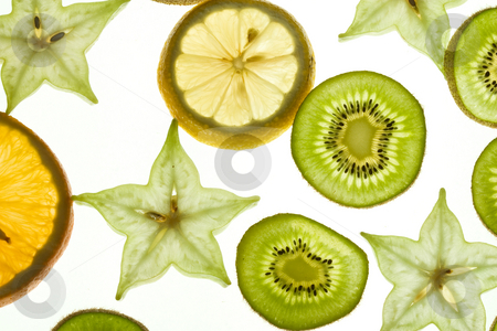 Slices fruit stock photo, Fruit background: slices carambola, orange and kiwi by Gennady Kravetsky