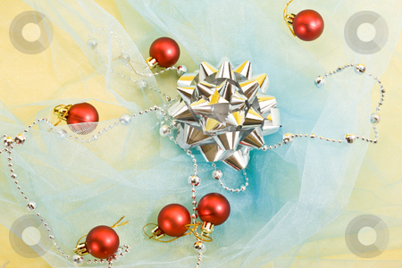 Christmas decoration stock photo, Holiday series: christmas silver bow with garland on blue by Gennady Kravetsky