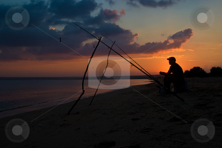 Fisherman stock photo, People series: fisherman sit on the beach of sea by Gennady Kravetsky