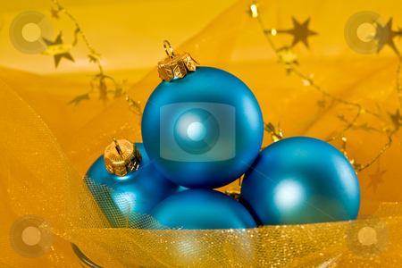 Christmas decoration stock photo, Holiday series: christmas blue ball and garland on yellow by Gennady Kravetsky