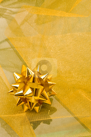Christmas decoration stock photo, Holiday series: christmas yellow knot shaped ribbon on cloth by Gennady Kravetsky
