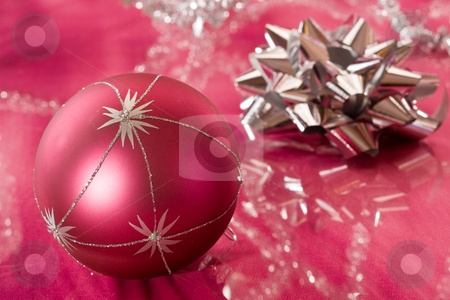 Christmas decoration stock photo, Holiday series: Christmas bow and ball decoration on the red by Gennady Kravetsky