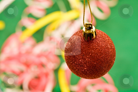 Christmas decoration stock photo, Holiday series: red Christmas ball and decorated background by Gennady Kravetsky