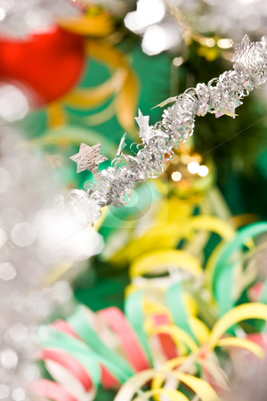 Christmas decoration stock photo, Holiday series: christmas star shaped garland on decorated fir background by Gennady Kravetsky