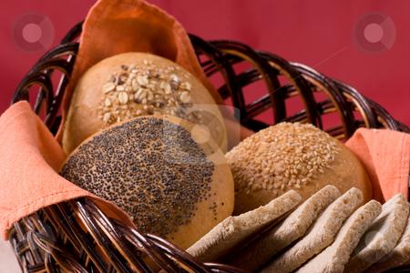 Buns stock photo, Some buns on the bread basket by Gennady Kravetsky