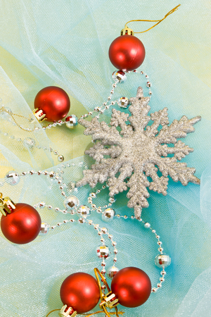 Christmas decoration stock photo, Holiday series: christmas decorated snowflake with garland on blue by Gennady Kravetsky