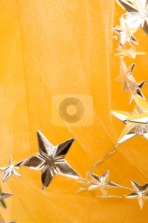 Stars stock photo, Holiday series: background of christmas silver stars over yellow by Gennady Kravetsky