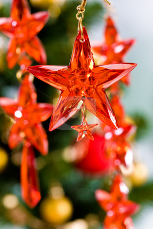 Christmas decoration stock photo, Holiday series:  Christmas decorated red star-shaped garland by Gennady Kravetsky