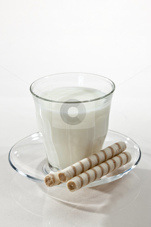 Milk and pastry stock photo, Food series: glass with milk and pstry on white by Gennady Kravetsky