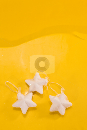 Christmas decoration stock photo, Holiday series: christmas white strar on yellow background by Gennady Kravetsky