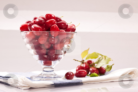 Cornelian cherries stock photo, Food series: glasssy bowl with ripe Cornelian cherries by Gennady Kravetsky