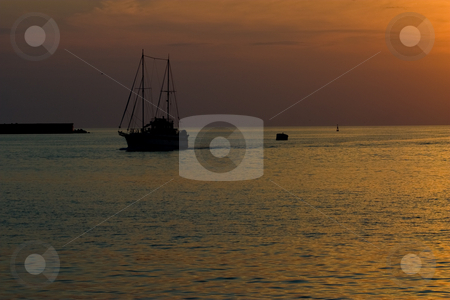 Yacht stock photo, Leisure series: yacht in the sea gulf in evening sunset by Gennady Kravetsky