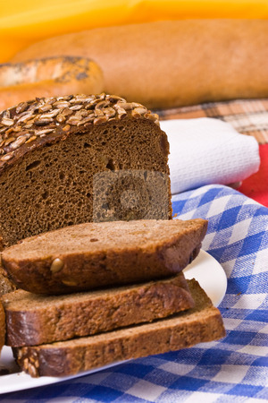 Slice bread stock photo, Still life with sliced bread on the yellow background by Gennady Kravetsky