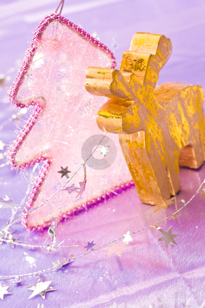 Golden deer stock photo, Holiday series: christmas golden deer with silver garland by Gennady Kravetsky