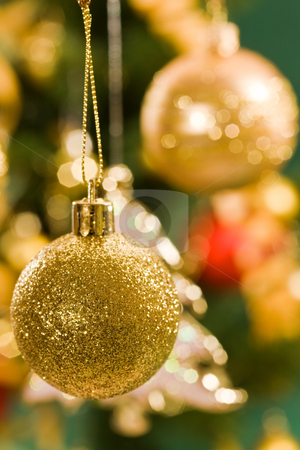 Christmas decoration stock photo, Holiday series: golden Christmas ball and decorated fir in background by Gennady Kravetsky