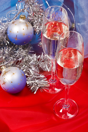 Christmas still life stock photo, Holiday series: Christmas still life with garland and champagne by Gennady Kravetsky