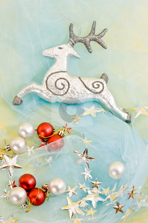 Christmas decoration stock photo, Holiday series: christmas silver deer with garland on blue by Gennady Kravetsky