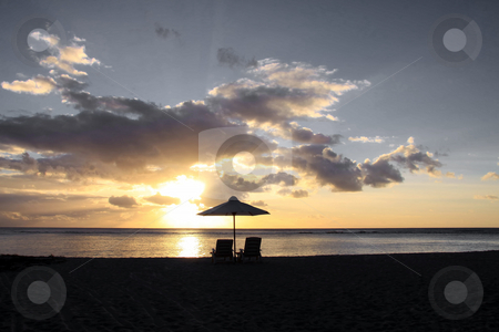 Sunset on the beach stock photo, Sunsetting on the beach of Flic en Flac on the island of mauritius. by Gowtum Bachoo