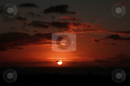 Tropical sunset. stock photo, Sunsetting during winter time on the island of mauritius. by Gowtum Bachoo