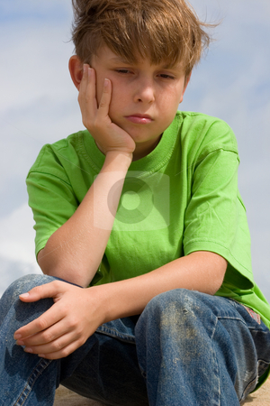 Unhappiness or Depression stock photo, Unhappy, lonely or sulky child. by Leah-Anne Thompson