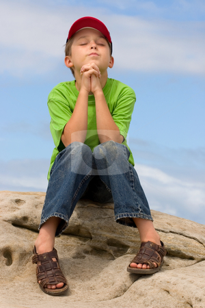 Prayer stock photo, A child in prayer by Leah-Anne Thompson