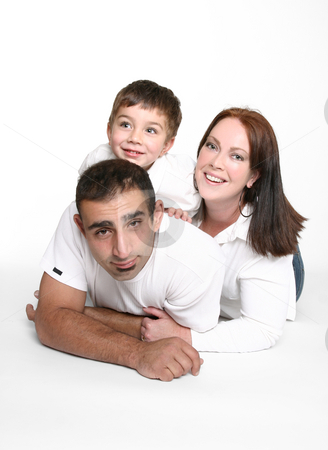 Happy family stock photo, Happy relaxed family lying on floor by Leah-Anne Thompson