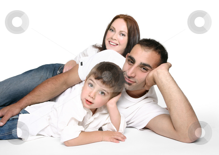 Casual family on floor stock photo, Casual family in jeans resting on the floor. by Leah-Anne Thompson