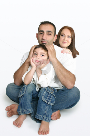 Happy family sitting on the floor stock photo,  by Leah-Anne Thompson