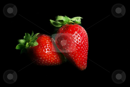 Strawberry Duet stock photo, Two ripe strawberries on black by Leah-Anne Thompson