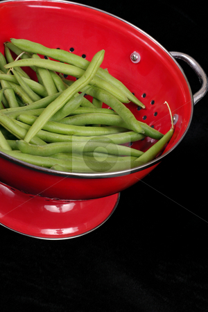 Green beans stock photo, Green beans contrast in a red colander by Leah-Anne Thompson