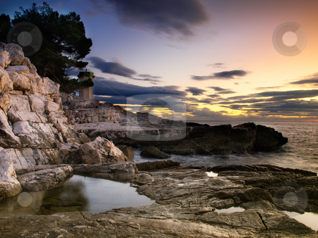 Lighthouse stock photo, Stone lighthouse in the background on the coast a few moments before lighting... by Sinisa Botas