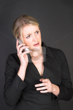 Beautiful Businesswoman stock photo, Worried looking blond businesswoman in conversation on the phone by Carla Booysen