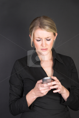 Beautiful Businesswoman stock photo, Beautiful blond businesswoman holding a cordless telephone by Carla Booysen