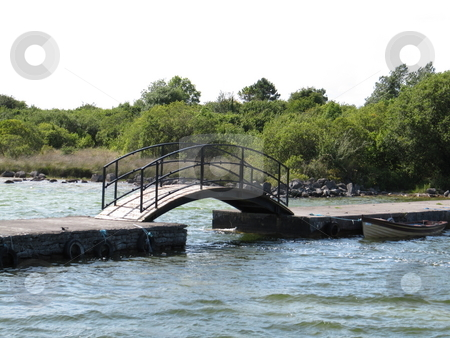 Footbridge stock photo, A footbridge on a pier with a rowing boat moored beside it by Michael O'Connell