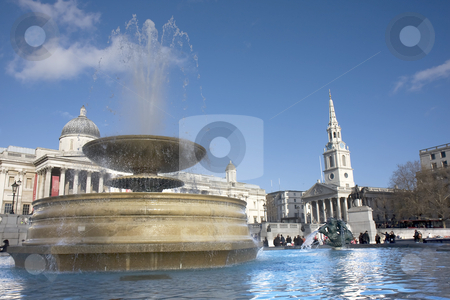 Trafalgar Square fountain stock photo, Close up of a fountain in Trafalgar Square with the National Gallery and St Martins in the Field in the background. by Darren Pattterson
