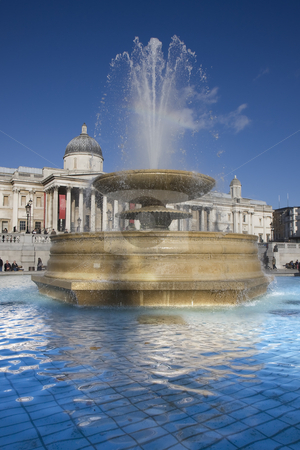 Trafalgar Square fountain portrait stock photo, Close up of a fountain in Trafalgar Square with the National Gallery in the background. by Darren Pattterson