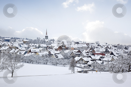 Winter village stock photo, A photography of a winter village snow land by Markus Gann