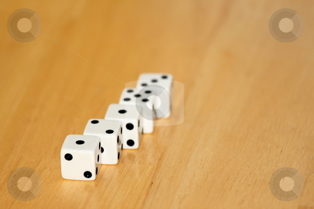 Dice stock photo, Five black and white dice on a wooden background by Henrik Lehnerer