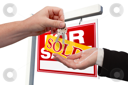 Agent Handing Over the Key to a New Home stock photo, Agent Handing Over the Key to a New Home with Real Estate Sign in the Background Isolated on White. by Andy Dean