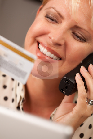 Beautiful Woman on Phone Holding Credit Card stock photo, Beautiful Woman on the Phone Holding Her Credit Card. by Andy Dean