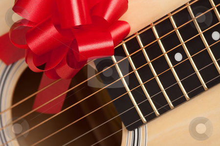 Guitar Strings with Red Ribbon stock photo, Guitar Strings with Red Ribbon - The Gift of Music. by Andy Dean