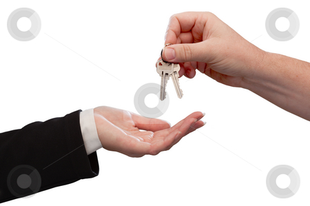Man Handing Over Woman Set Of Keys stock photo, Man Handing Over Woman Set of Keys Isoltaed on a White Background. by Andy Dean