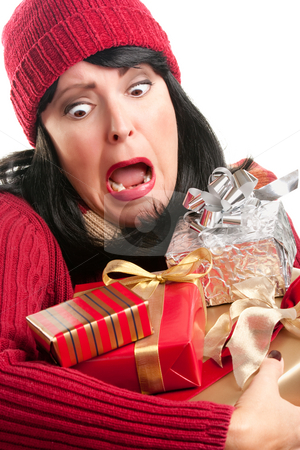 Excited Woman Balancing Holiday Gifts stock photo, Excited, Attractive Woman Balancing Holiday Gifts Isolated on a White Background. by Andy Dean