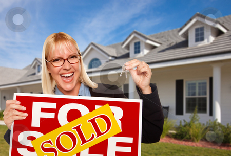 Beautiful Female Holding Keys & Sold Real Estate Sign stock photo, Beautiful Female Holding Keys to a New House & Sold Real Estate Sign. by Andy Dean
